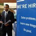 A job seeker walks the floor at a large career fair at Rutgers University
