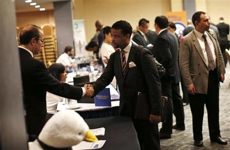 Reuters/Reuters - A job seeker (R) meets with a prospective employer at a career fair in New York City, October 24, 2012. REUTERS/Mike Segar
